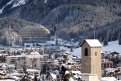 The golden dome of the new InterContinental hotel left operated by InterContinental Hotels Group Plc sits above snow covered buildings in the town of...