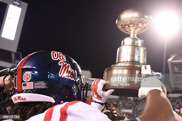 The Golden Egg is lifted by members of the Mississippi Rebels following a victory over the Mississippi State Bulldogs at Davis Wade Stadium on...
