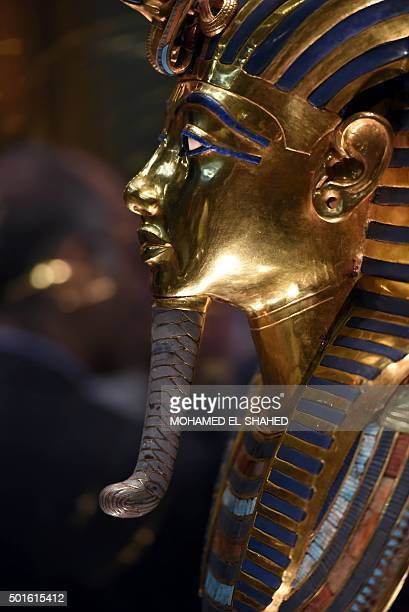 The golden funerary mask of legendary Egyptian boy king Tutankhamun is displayed at the Egyptian Museum in Cairo after its restoration on December 16...