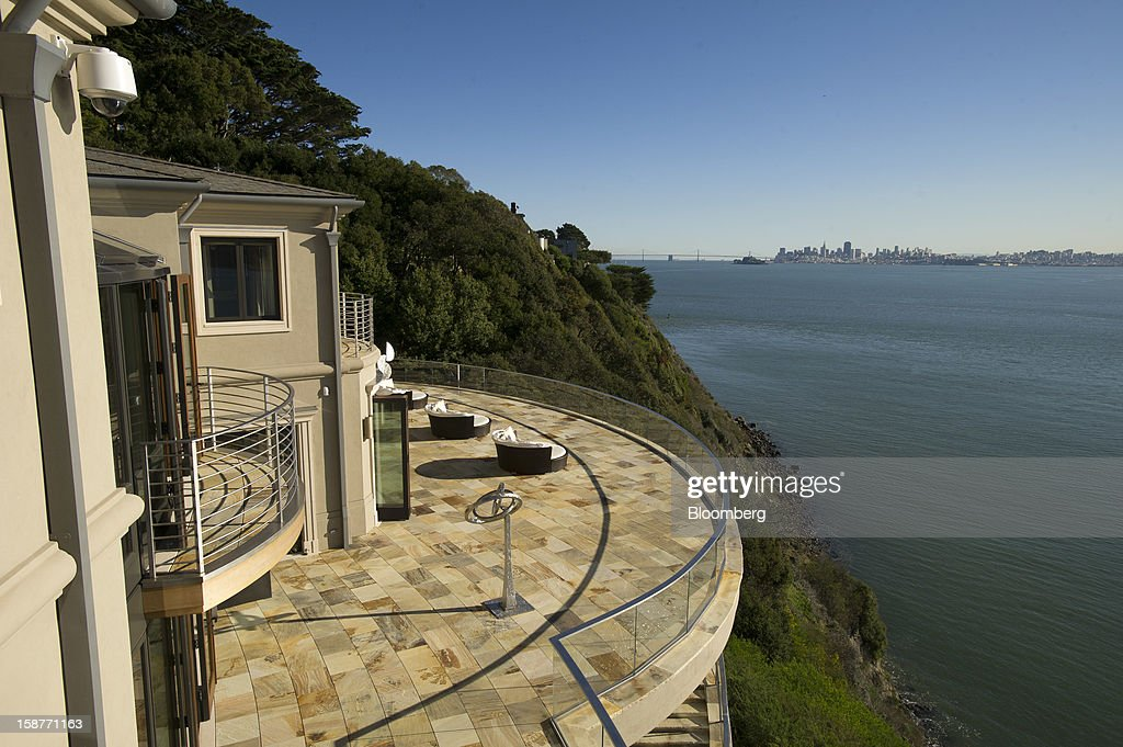 The Golden Gate Bridge and the city of San Francisco are seen in the distance in this view from a 15,000 square-foot custom built home on Belvedere Island in Marin County, California, U.S., on Wednesday, Dec. 19, 2012. The builder couldn't find a buyer for the brand-new waterfront mansion he listed in January for $45 million. He hopes one will turn up at a Dec. 30 auction, where the starting bid will be $25 million. Photographer: David Paul Morris/Bloomberg via Getty Images