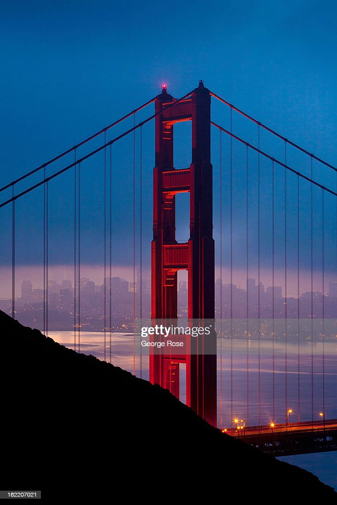 The Golden Gate Bridge is aglow in lights just before sunrise on February 13, 2013, in San Francisco, California. Some 13.6 million international travelers visit the State each year generating nearly $100 billion in revenue and creating approximately 900,000 jobs in the arts, entertainment, recreation, food service and accomodations sectors.