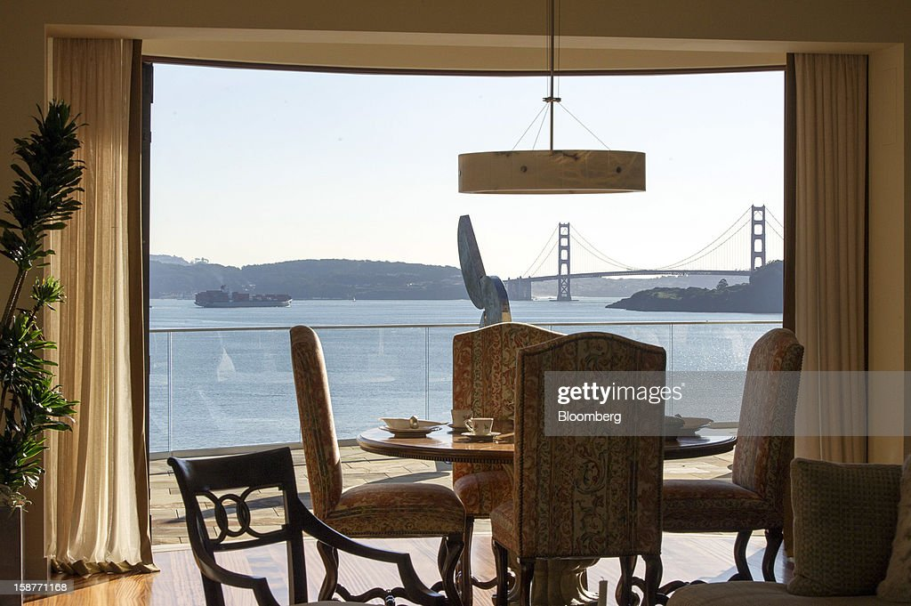 The Golden Gate Bridge is seen from the dining room of a 15,000 square-foot custom built home on Belvedere Island in Marin County, California, U.S., on Wednesday, Dec. 19, 2012. The builder couldn't find a buyer for the brand-new waterfront mansion he listed in January for $45 million. He hopes one will turn up at a Dec. 30 auction, where the starting bid will be $25 million. Photographer: David Paul Morris/Bloomberg via Getty Images
