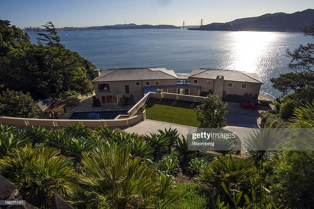 The Golden Gate Bridge is seen in the view from a 15,000 square-foot custom built home on Belvedere Island in Marin County, California, U.S., on Wednesday, Dec. 19, 2012. The builder couldn't find a buyer for the brand-new waterfront mansion he listed in January for $45 million. He hopes one will turn up at a Dec. 30 auction, where the starting bid will be $25 million. Photographer: David Paul Morris/Bloomberg via Getty Images