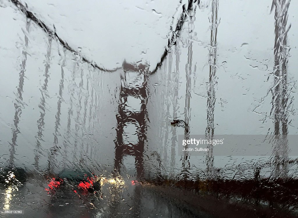 The Golden Gate Bridge is seen through a rain covered windshield on December 11 2014 in Larkspur California The San Francisco Bay Area is being hit...