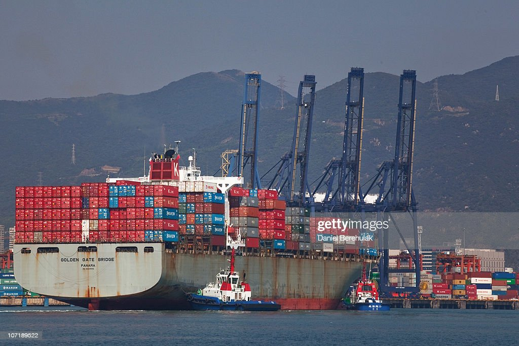 The Golden Gate Panama cargo ship navigates its way into Shenzhen Port as it docks on November 28, 2010 in Shenzhen, China. According to the US Commercial Service, Shenzhen is one of the fastest growing cities in the world. Home of the Shenzhen Stock Exchange and the headquarters of numerous technology companies, the now bustling former fishing village is considered southern China's major financial centre.