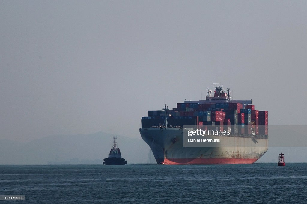The Golden Gate Panama cargo ship navigates its way into Shenzhen Port on November 28, 2010 in Shenzhen, China. According to the US Commercial Service, Shenzhen is one of the fastest growing cities in the world. Home of the Shenzhen Stock Exchange and the headquarters of numerous technology companies, the now bustling former fishing village is considered southern China's major financial centre.