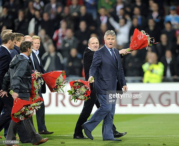 The golden PSV Eindhoventeam of 1988 led by Guus Hiddink walk on the field during the halftime of the UEFA Europa league quarterfinals secondleg...