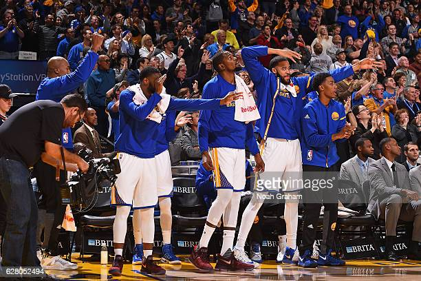 The Golden State Warriors bench reacts to a three point basket during the game against the Indiana Pacers on December 5 2016 at ORACLE Arena in...