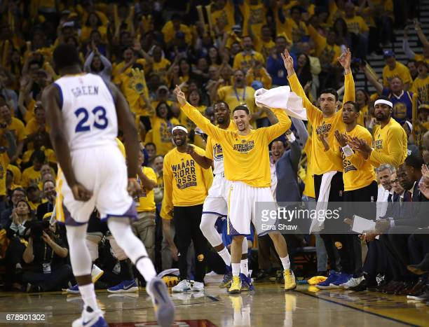 The Golden State Warriors bench reacts to a threepoint basket hit by Draymond Green against the Utah Jazz during Game Two of the NBA Western...