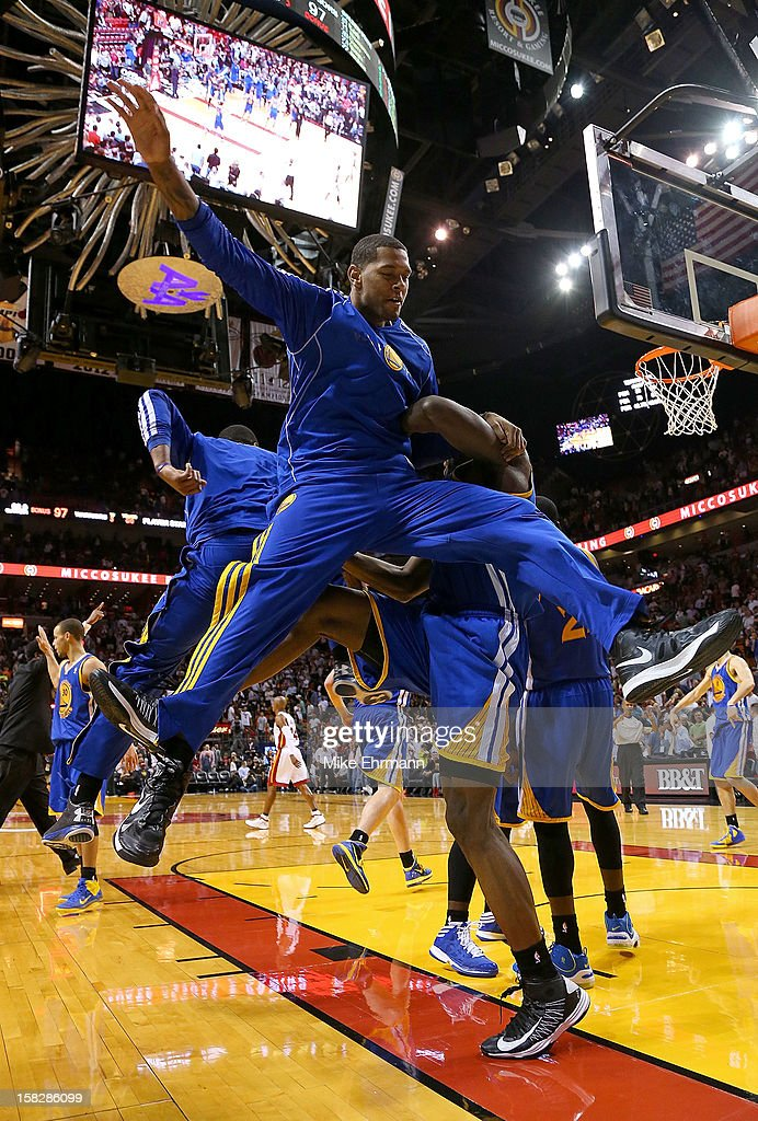 The Golden State Warriors celebrate after winning a game against the Miami Heat at American Airlines Arena on December 12, 2012 in Miami, Florida.