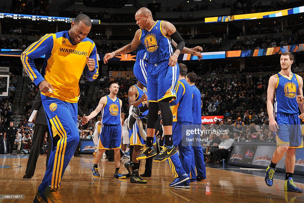 The Golden State Warriors celebrate during a game against the Denver Nuggets on April 16, 2014 at the Pepsi Center in Denver, Colorado.