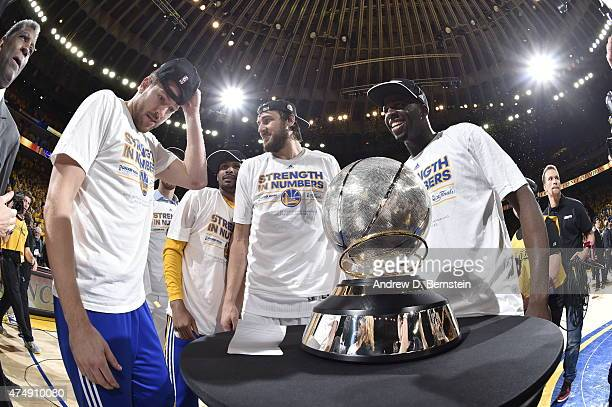 The Golden State Warriors celebrate winning Game Five of the Western Conference Finals against the Houston Rockets during the 2015 NBA Playoffs on...