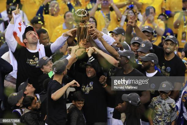 The Golden State Warriors celebrate with the Larry O'Brien Championship Trophy after defeating the Cleveland Cavaliers 129120 in Game 5 to win the...