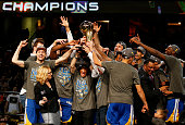 The Golden State Warriors celebrates with the Larry O'Brien NBA Championship Trophy after winning Game Six of the 2015 NBA Finals against the...