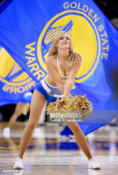 The Golden State Warriors cheerleaders the Warrior Girls performs against the Dallas Mavericks at ORACLE Arena on February 4 2015 in Oakland...
