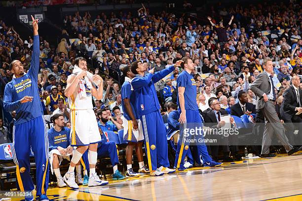 The Golden State Warriors cheers while facing the Portland Trail Blazers on April 9 2015 at Oracle Arena in Oakland California NOTE TO USER User...