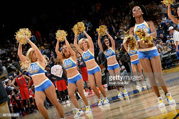 The Golden State Warriors dance team performs during a game against the Washington Wizards on March 23 2015 at Oracle Arena in Oakland California...