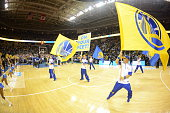 The Golden State Warriors flag handlers excite the crowd before the Golden State Warriors face off against the Toronto Raptors on October 5 2015 at...