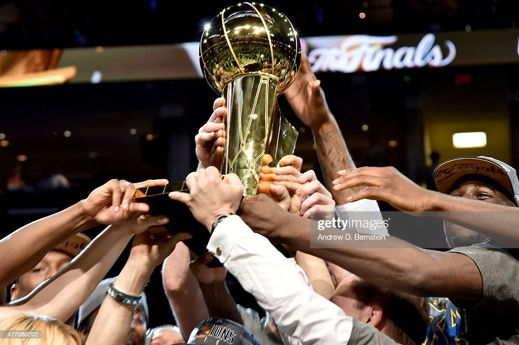 The Golden State Warriors hoist the Larry O'Brien Trophy after a victory over the Cleveland Cavaliers in Game Six to win the 2015 NBA Finals at The...