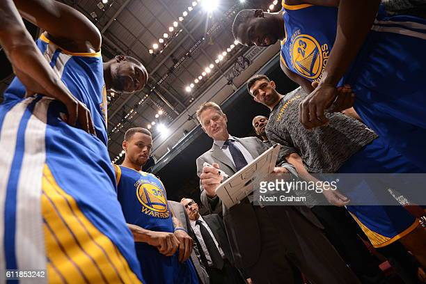 The Golden State Warriors huddle around Head Coach Steve Kerr during the game against the Toronto Raptors during a preseason game on October 1 2016...
