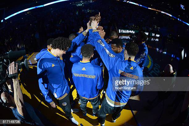 The Golden State Warriors huddle up before facing the Los Angeles Clippers on March 23 2016 at Oracle Arena in Oakland California NOTE TO USER User...