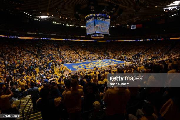 The Golden State Warriors hype crew gets the crowd into the game against the Portland Trail Blazers during Game Two of the Western Conference...
