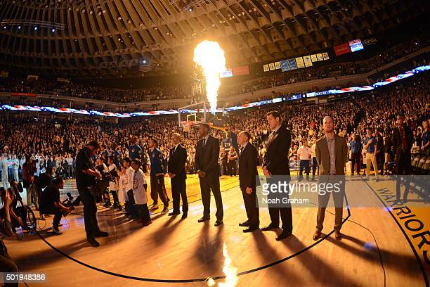 The Golden State Warriors line up during the national anthem of the game against the Milwaukee Bucks on December 18 2015 at Oracle Arena in Oakland...