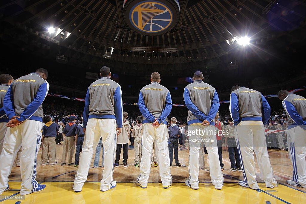 The Golden State Warriors line up for the national anthem before a game against the Portland Trail Blazers on January 11, 2013 at Oracle Arena in Oakland, California.