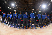 The Golden State Warriors line up for the national anthem before facing the Toronto Raptors on November 17 2015 at Oracle Arena in Oakland California...