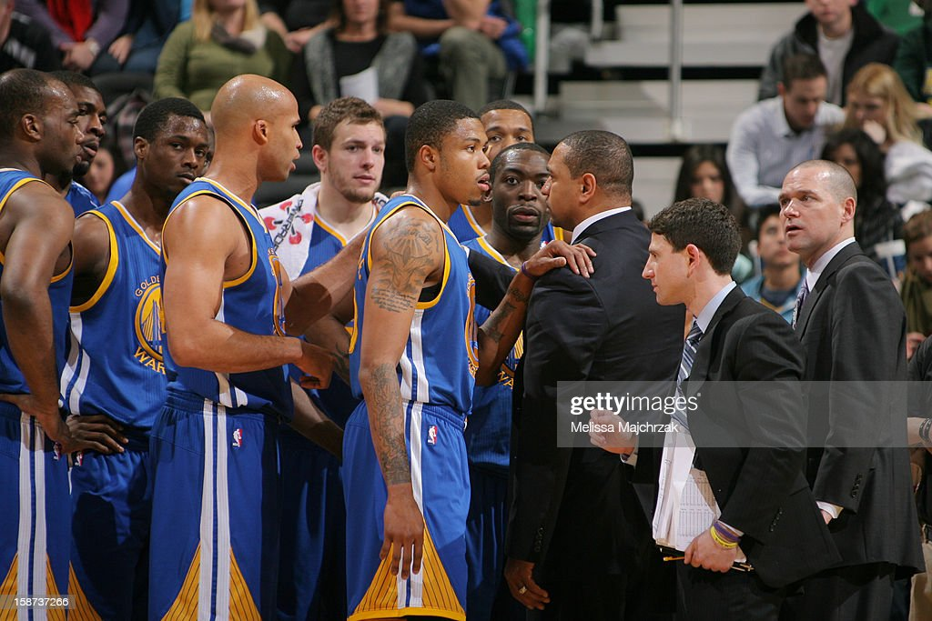 The Golden State Warriors listen to Head Coach Mark Jackson during a timeout against the Utah Jazz at Energy Solutions Arena on December 26, 2012 in Salt Lake City, Utah.