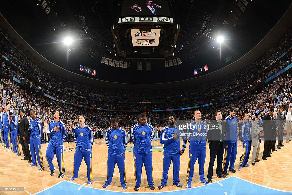 The Golden State Warriors listen to the National Anthem before playing against the Denver Nuggets in Game Two of the Western Conference Quarterfinals during the 2013 NBA Playoffs on April 23, 2013 at the Pepsi Center in Denver, Colorado.