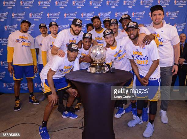 The Golden State Warriors pose for a photo with the Western Conference Championship Trophy after winning Game Four of the Western Conference Finals...