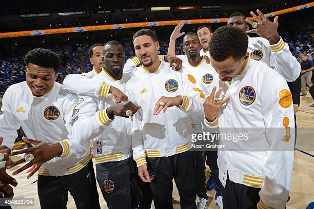 The Golden State Warriors pose for a team photo after getting their 2015 Championship rings before the game against the New Orleans Pelicans on...