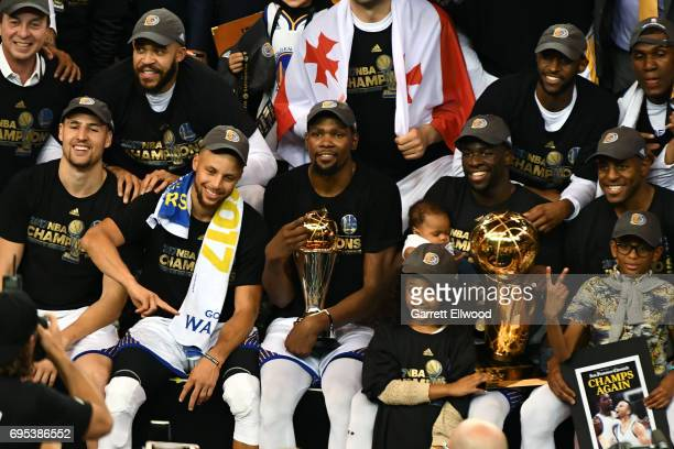 The Golden State Warriors pose for a team photo after winning the NBA Championship and defeating the Cleveland Cavaliers in Game Five of the 2017 NBA...