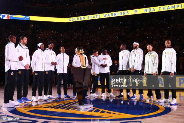 The Golden State Warriors stand during their 2017 NBA Championship ring ceremony prior to their NBA game against the Houston Rockets at ORACLE Arena...