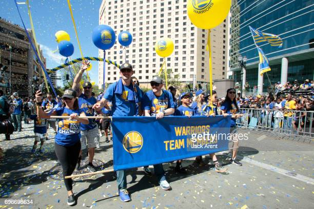 The Golden State Warriors team members celebrates with fans after winning the 2017 NBA Championship during a parade on June 15 2017 in Oakland CA...