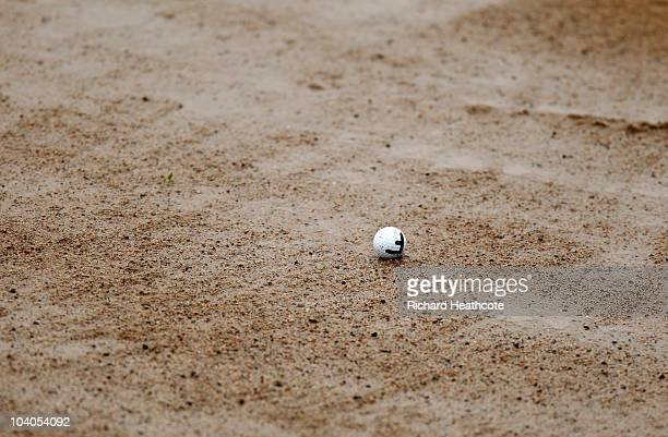 The golf ball of Oscar Floren of Sweden sits in a wet bunker during the final round of the Kazakhstan Open at the Zhailjau Golf Resort on September...