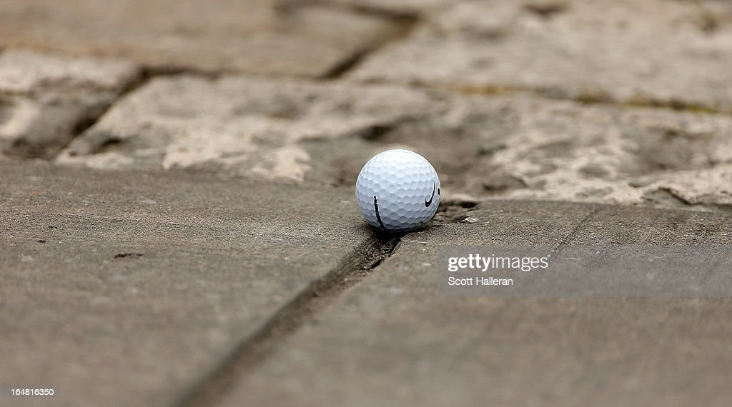 The golf ball of Rory McIlroy comes to rest on the cart path on the second hole during the first round of the Shell Houston Open at the Redstone Golf Club on March 28, 2013 in Humble, Texas.