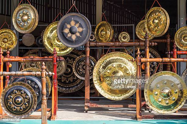 The gong village of Phibun Mangsahan near the confluence of the Mekong and Mun Rivers at Khong Chiam is famous for its hand forged bronze gongs used...