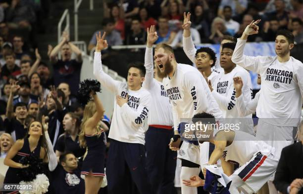 The Gonzaga Bulldogs bench reacts in the first half against the Xavier Musketeers during the 2017 NCAA Men's Basketball Tournament West Regional at...