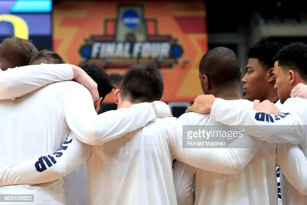 The Gonzaga Bulldogs huddle on the court before their game against the South Carolina Gamecocks during the 2017 NCAA Men's Final Four Semifinal at...