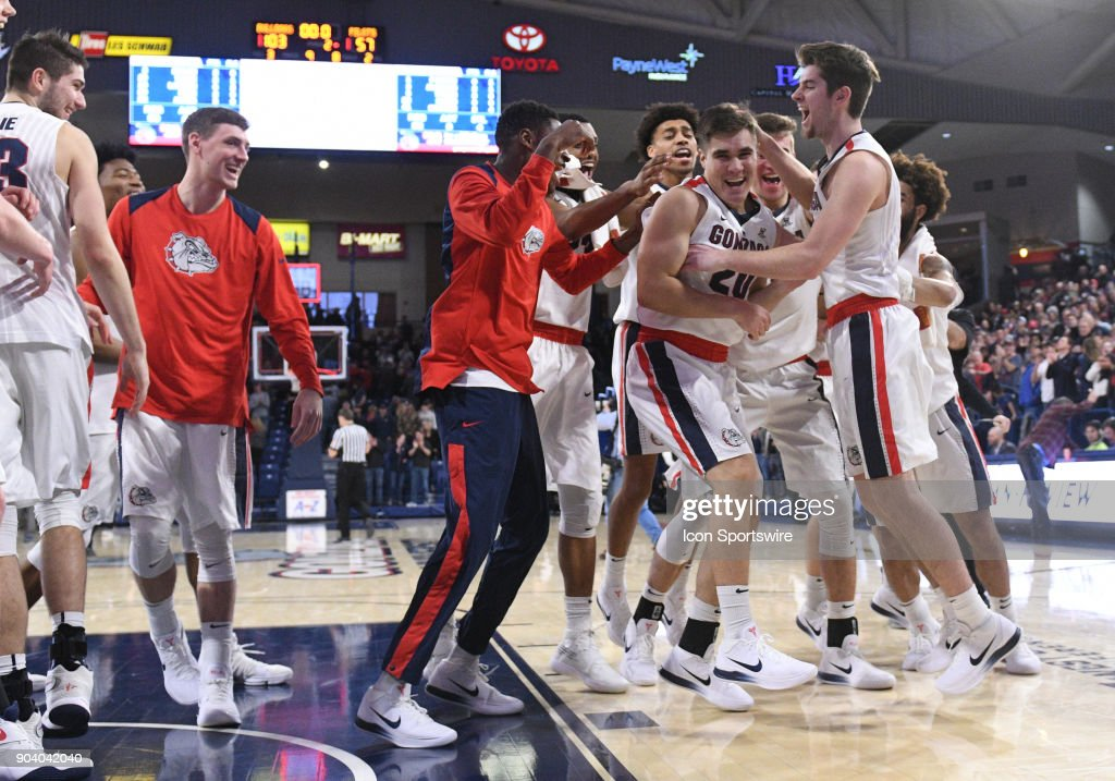 the Gonzaga team swarms former manager and little-used reserve GU guard Brian Pete (20) for scoring a basket following the game between the Portland Pilots and the Gonzaga Bulldogs played on January 11, 2018, at McCarthey Athletic Center in Spokane, WA.