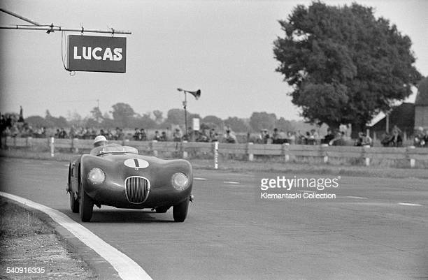 The Goodwood 9 Hours August 16 1952 Stirling Moss with the works Jaguar Ctype at Fordwater flat ot He drove with Peter Walker and finished fifth