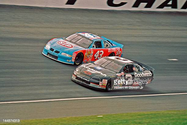 The Goodwrench Service and STP cars on the track during the Winston Cup Race at the Charlotte Motor Speedway Charlotte North Carolina 1997