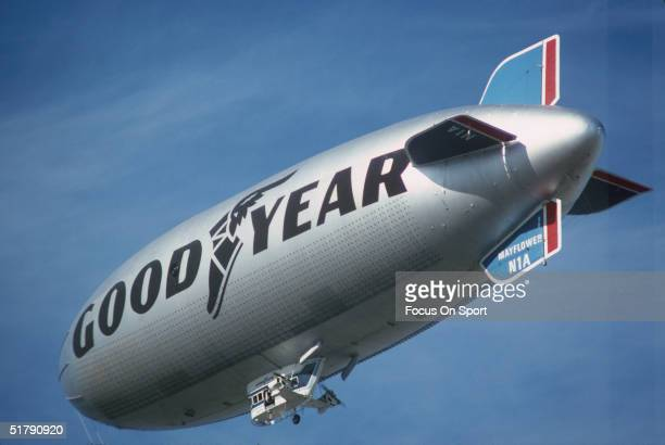The Goodyear Blimp flies in the air