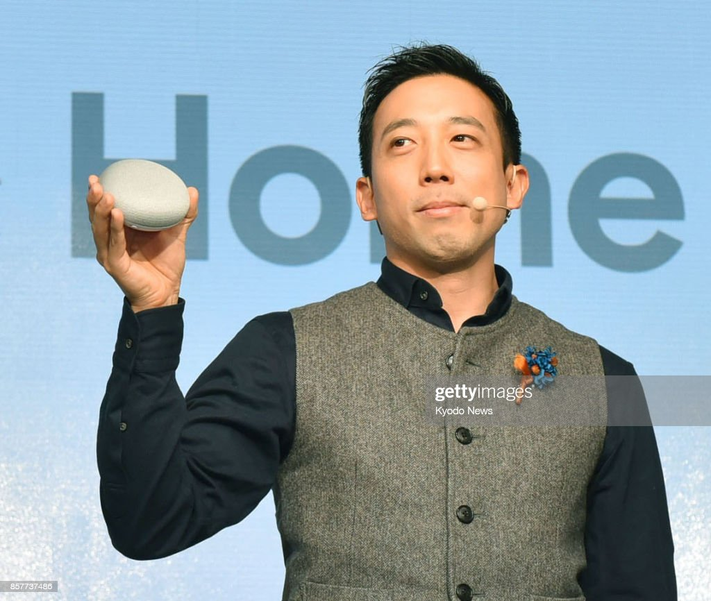 The Google Home Mini smart speaker, as shown during a press event in Tokyo on Oct. 5, 2017, will be sold in Japan from Oct. 6. It is the compact version of the Google Home, which will also become available. ==Kyodo