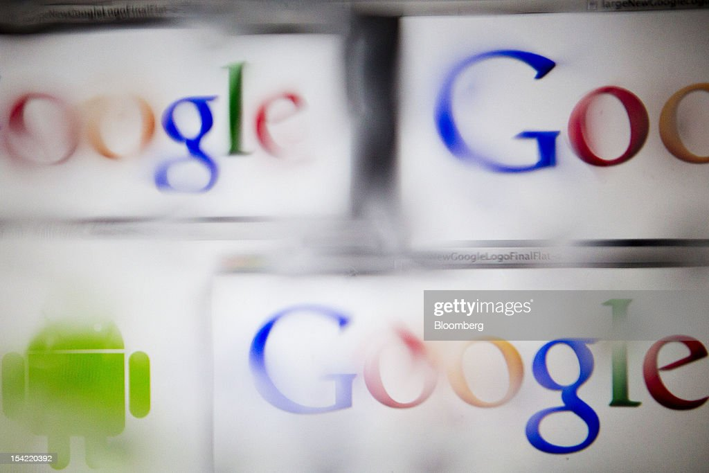 The Google Inc. and Android logos are seen through water droplets for an arranged photograph in Washington, D.C., U.S., on Monday, Oct. 15, 2012. Google Inc. is scheduled to release earnings data on Oct. 18. Photographer: Andrew Harrer/Bloomberg via Getty Images