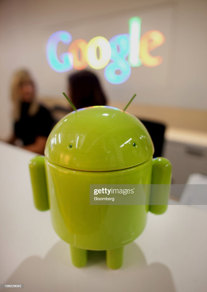 The Google Inc. Android character stands at the front desk during a media tour for the grand opening of Google Inc.'s new office in Toronto, Ontario, Canada, on Tuesday, Nov. 13, 2012. The office space encompasses five color-coded floors and features amenities such as a pool table, video games, mini-golf putting greens and a camping lounge where employees can hold meetings in a tent. Photographer: Brett Gunlock/Bloomberg via Getty Images