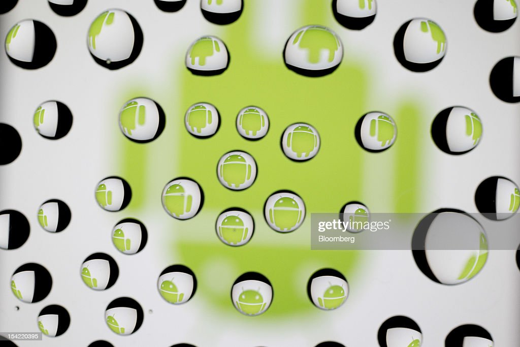 The Google Inc. Android logo is reflected in water droplets for an arranged photograph in Washington, D.C., U.S., on Monday, Oct. 15, 2012. Google Inc. is scheduled to release earnings data on Oct. 18. Photographer: Andrew Harrer/Bloomberg via Getty Images