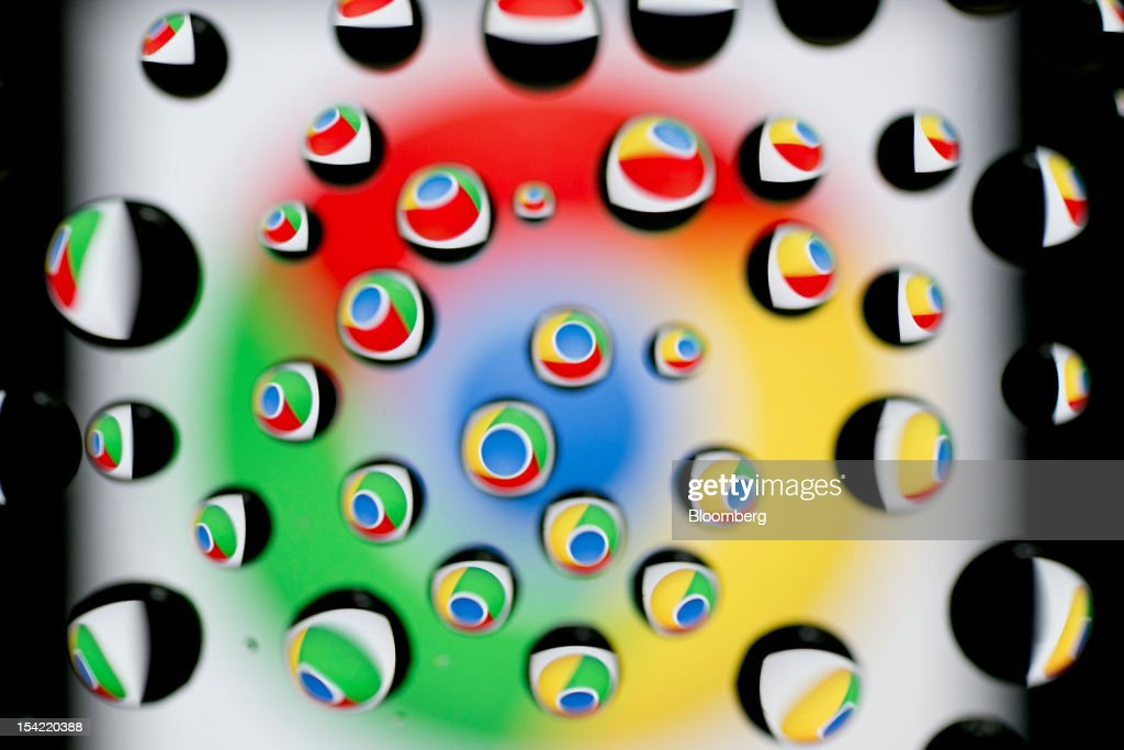 The Google Inc. Chrome icon is reflected in water droplets for an arranged photograph in Washington, D.C., U.S., on Monday, Oct. 15, 2012. Google Inc. is scheduled to release earnings data on Oct. 18. Photographer: Andrew Harrer/Bloomberg via Getty Images